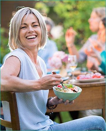 Woman eating mixed salad